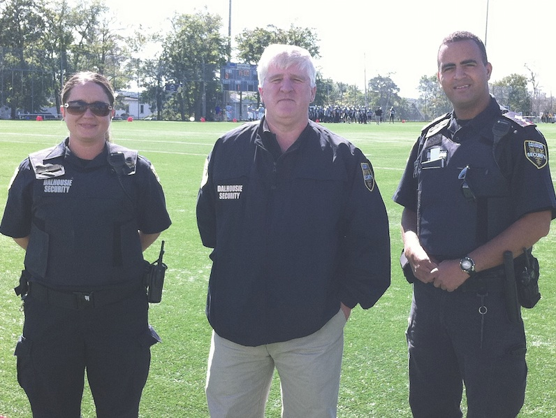 Mike Burns (centre), director of security, and Dalhousie security officers at Wickwire Field. Photo by Kristie-Lynn Smith.
