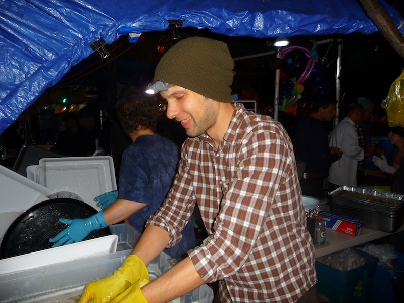 Phil Boydelatour washing supper dishes at Zuccotti Park Oct. 11. Photo by Katrina Pyne.