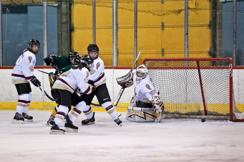 Katie Brewster, in green, scores the game's opening goal in the second period. Photo by Paul Balite.