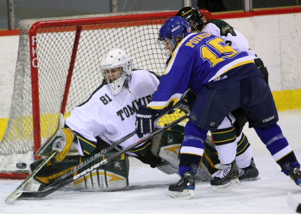 Moncton's Marie-M. Poirier crashes the net. Photo by Dal Athletics.
