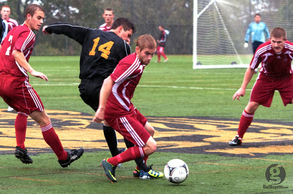 Dal's James Nearing tries to get a foot on the ball as his opponent breaks for it. (Chris Parent photo)