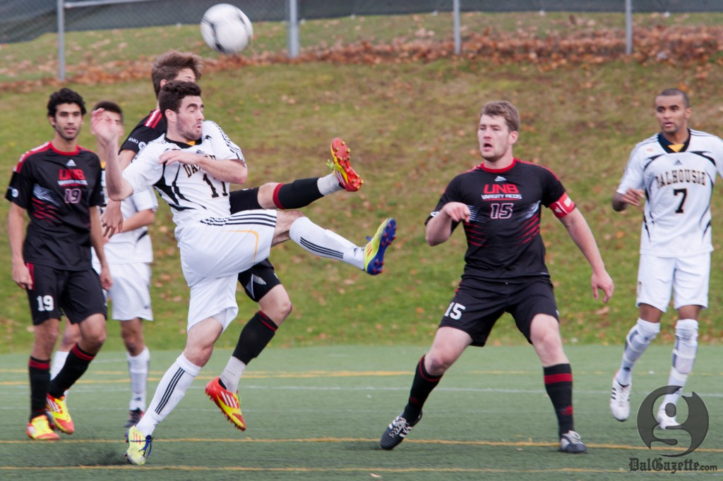 Tyler Lewars fights for possession in Dal's fourth consecutive semifinal loss. (Photo via UPEI Photography)