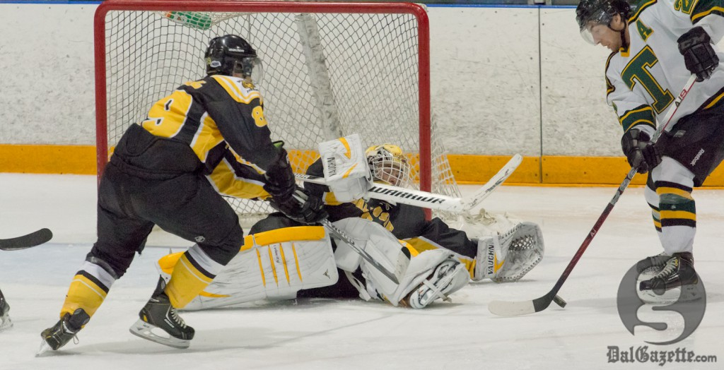 Tigers keeper Bobby Nadeau makes a desperation save against St. Thomas Jan. 25. (David Munro photo)