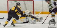 Tigers keeper Bobby Nadeau makes a desperation save against St. Thomas Jan. 25. (David Munro photo)