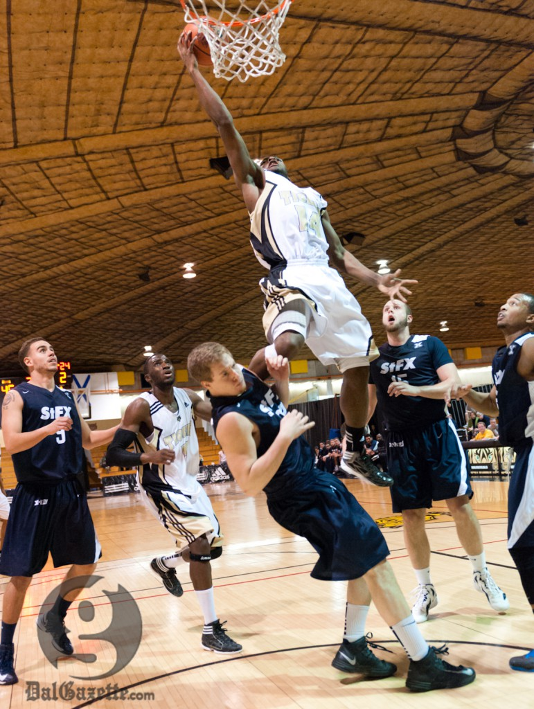 Kashrell Lawrence goes airborne in an authoritative Tigers victory. (Chris Parent photo)