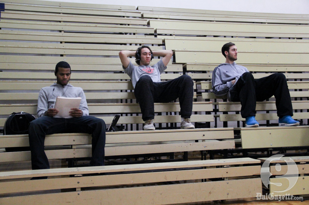 The men's Tigers relax as their female counterparts take the court before their game. (Monica Mutale photo)