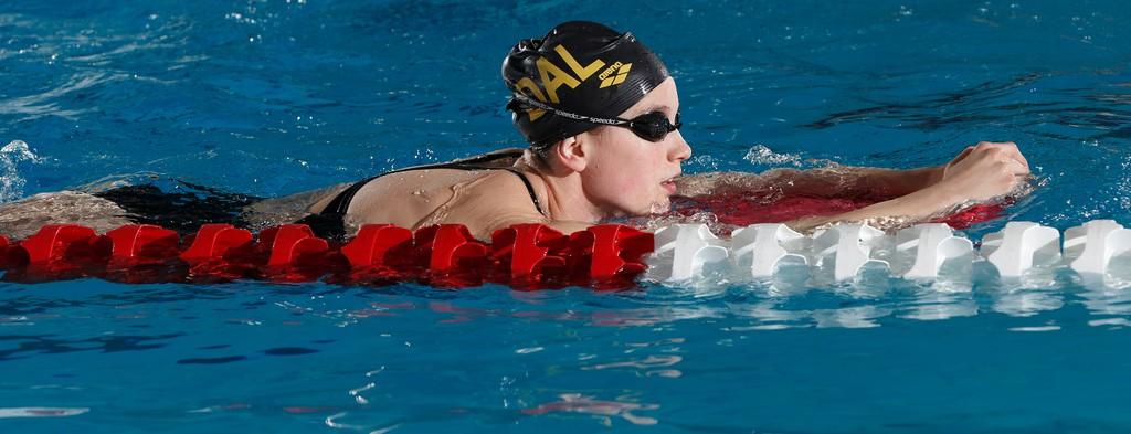 Graduating swimmer Emmalina Corriveau finished eighth in the 200 backstroke. (Photo by David Moll via University of Calgary)