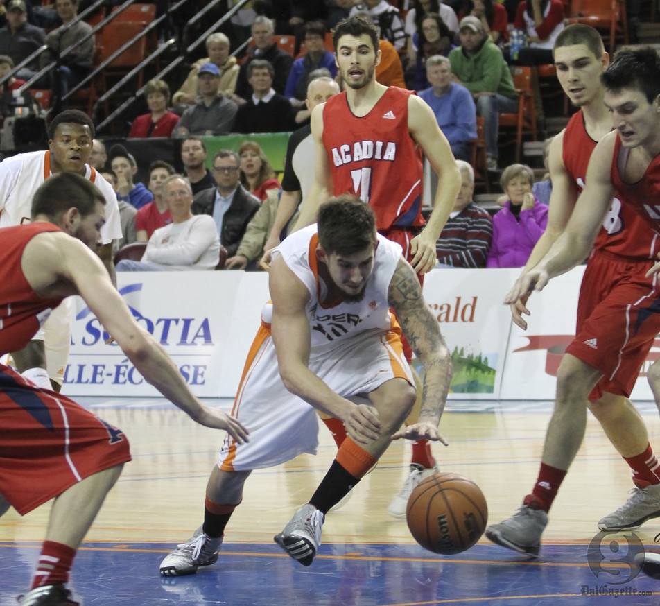 Sean McCormick, middle, had nine points and five steals in Cape Breton's victory. (Shauna Brown photo)