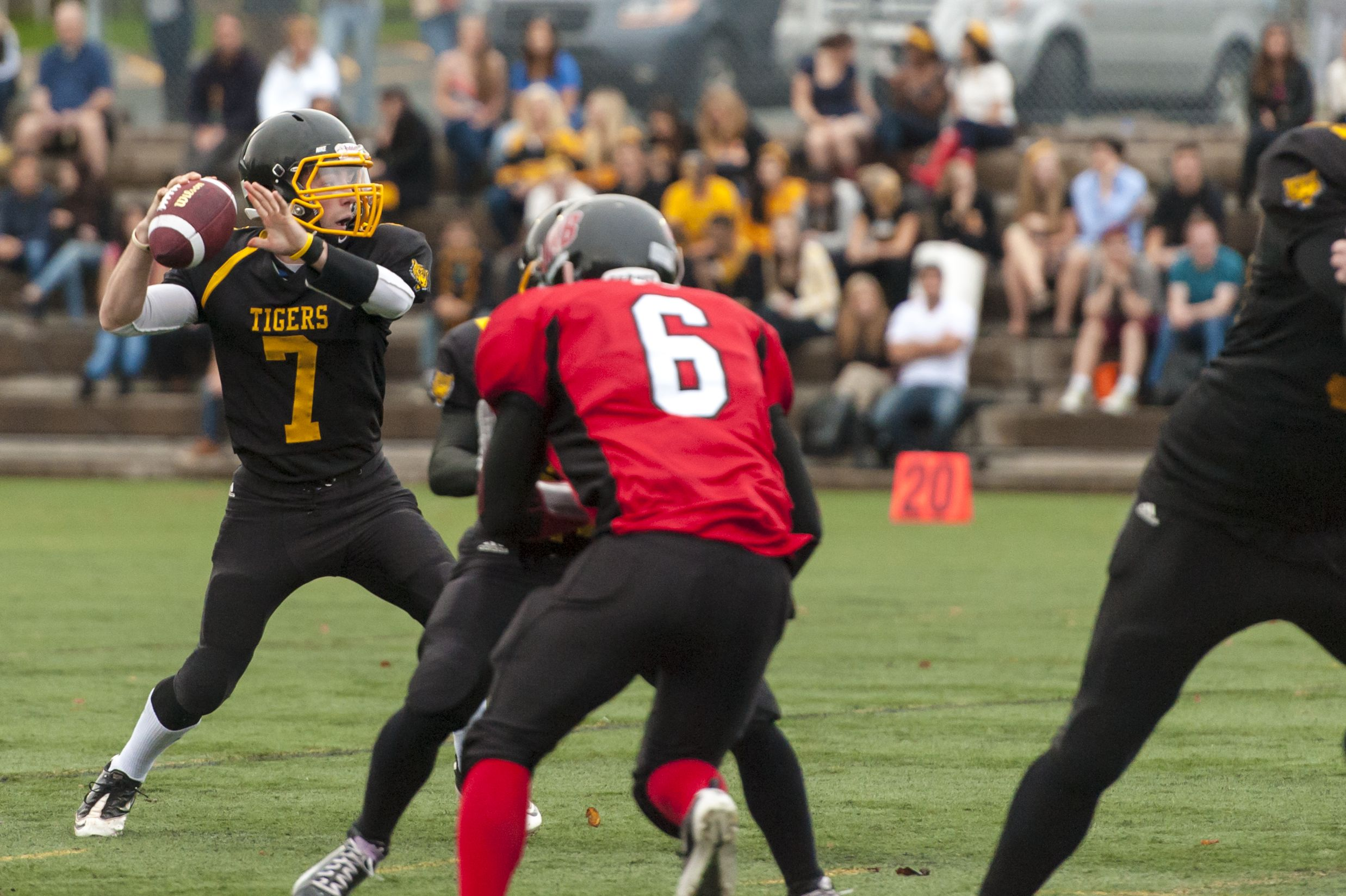 Nick Hunsley (7) drops back to pass in the Sept. 14 game. (Chris Parent photo)