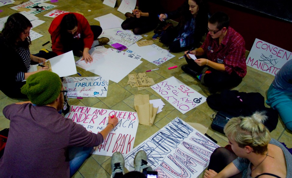 Protesters made signs at the SUB before rallying to the march (photo by Chris Parent