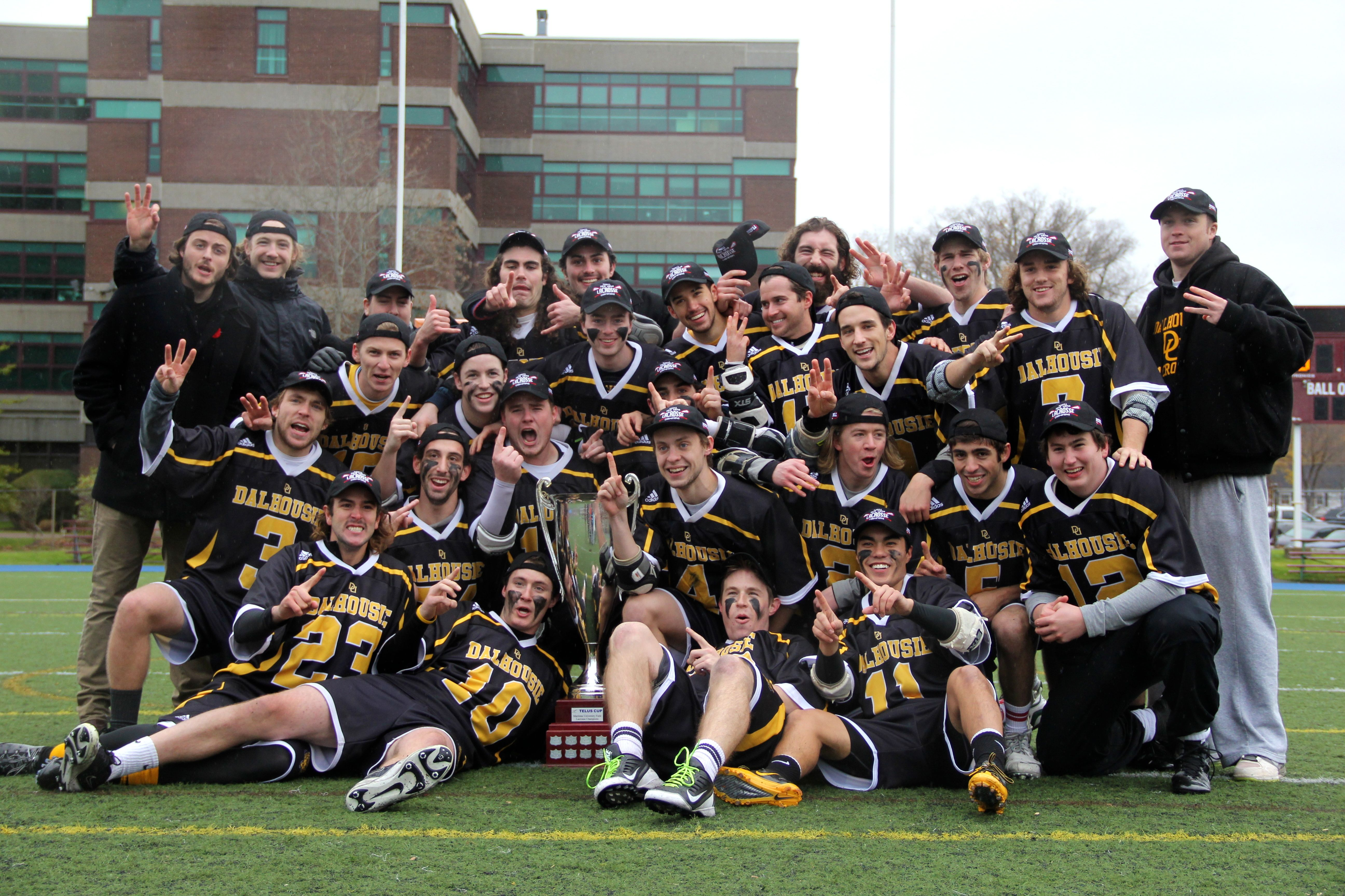 The Tigers are getting used to posing for celebratory photos. (Photo by Ian Froese)
