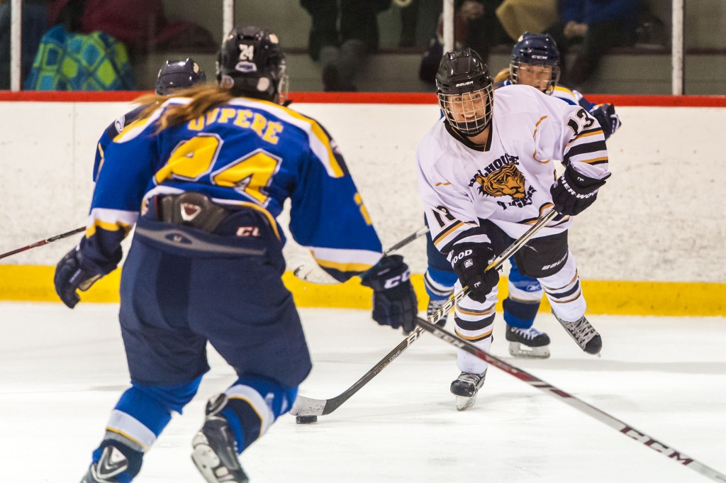 Rookie Marita Alferi corrals the puck in a game earlier this month. (Photo by Chris Parent)