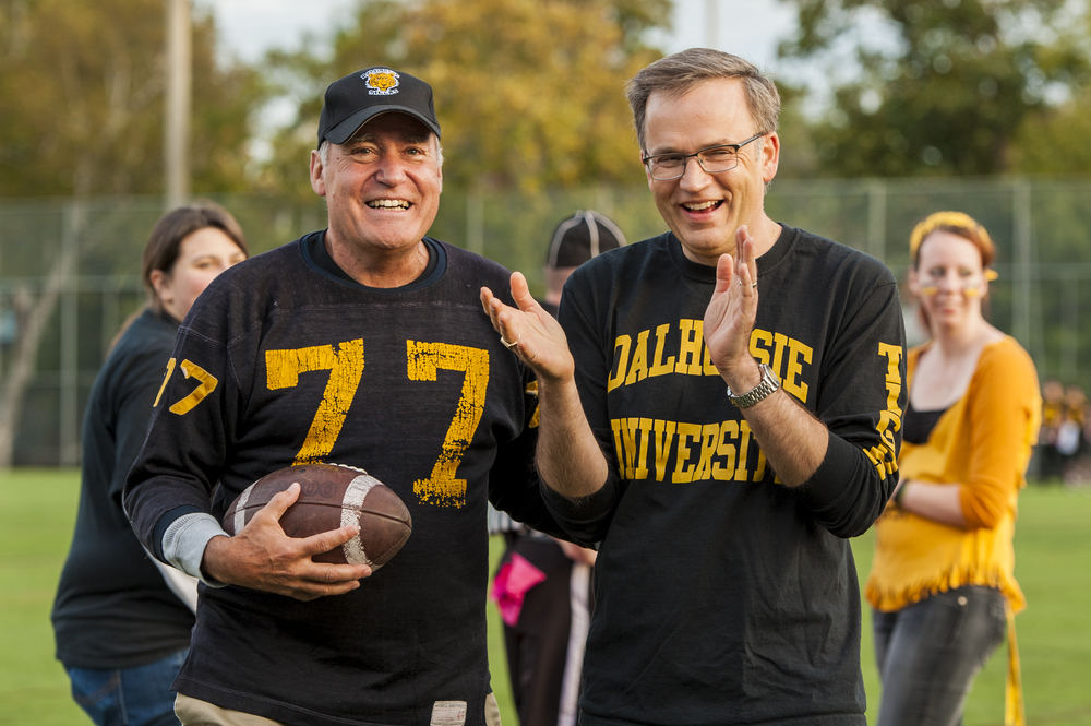 Dalhousie Alumni Association president Barrie Black, left, with Richard Florizone at the 2013 homecoming football game. (Photo by Chris Parent via Dal News)