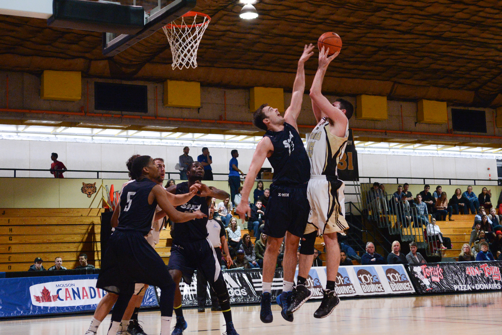 Devon Stedman (15) puts up a contested shot in the paint. (Photo by Kit Moran)