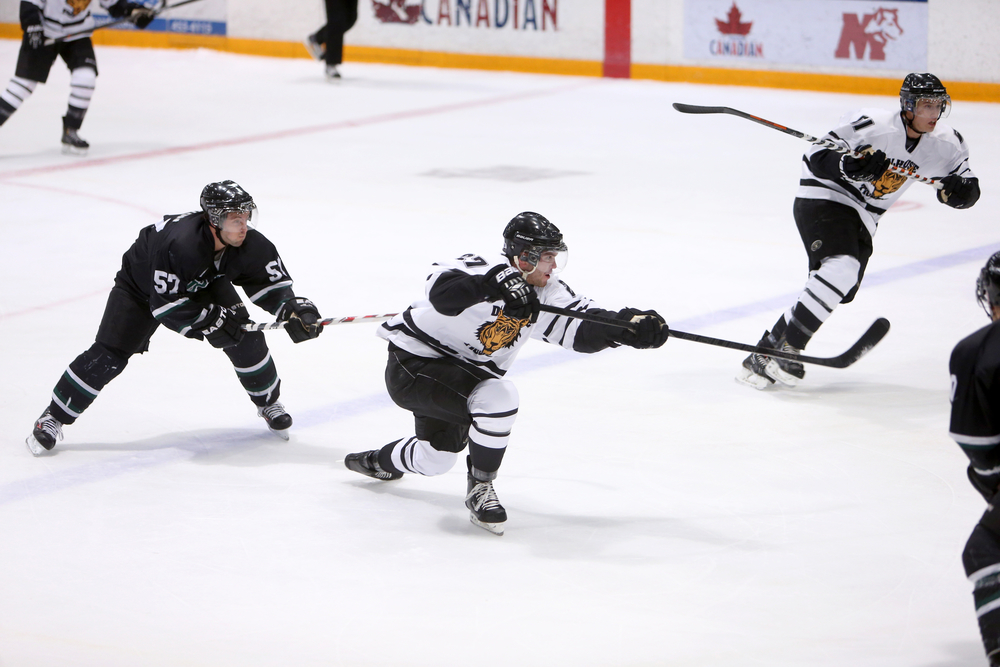 Brett Theberge (27) puts a shot on net in an earlier contest. (Photo by Nick Pearce via Dal Athletics)