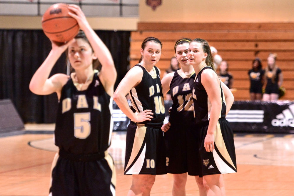 Tessa Stammberger (10) confers with her Tigers teammates. (Photo by Kit Moran)