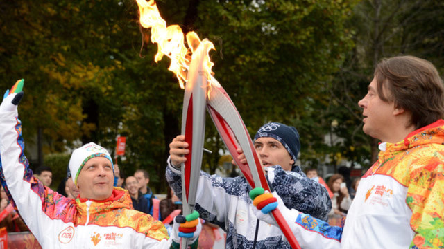 Torchbearers with the Olympic flame