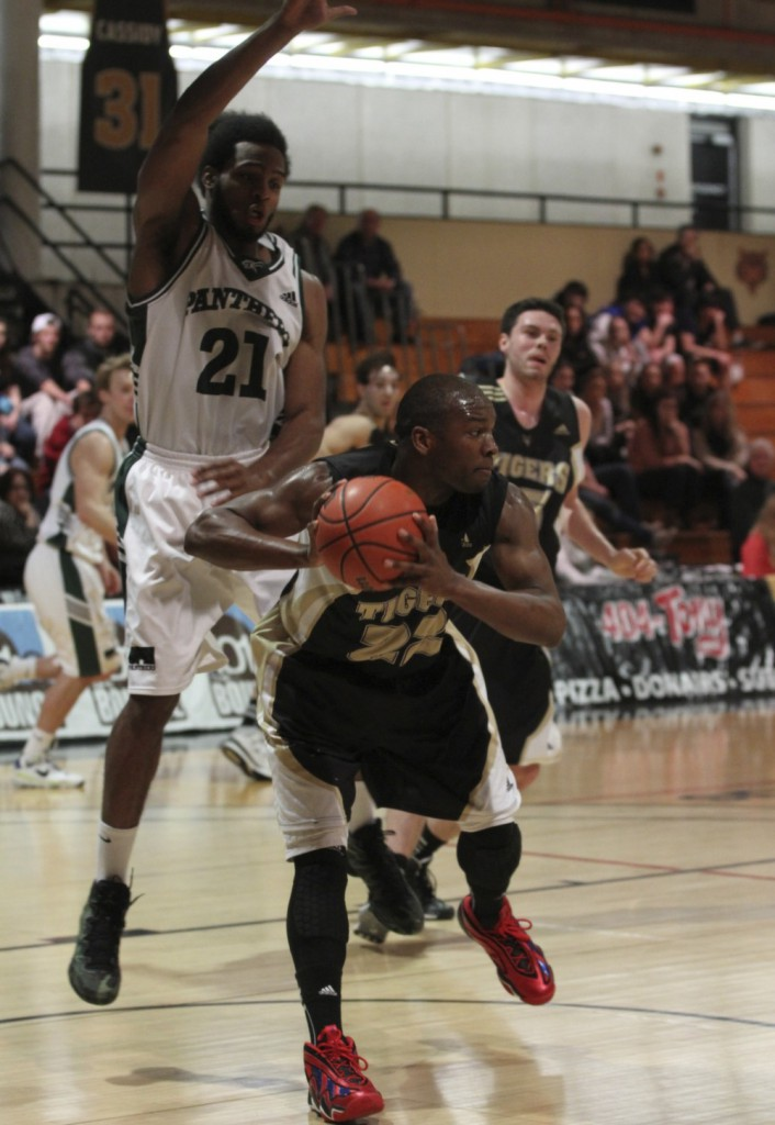 Kashrell Lawrence (22) looks for an opening against the high-flying Panthers. (Photo by Shauna Brown)
