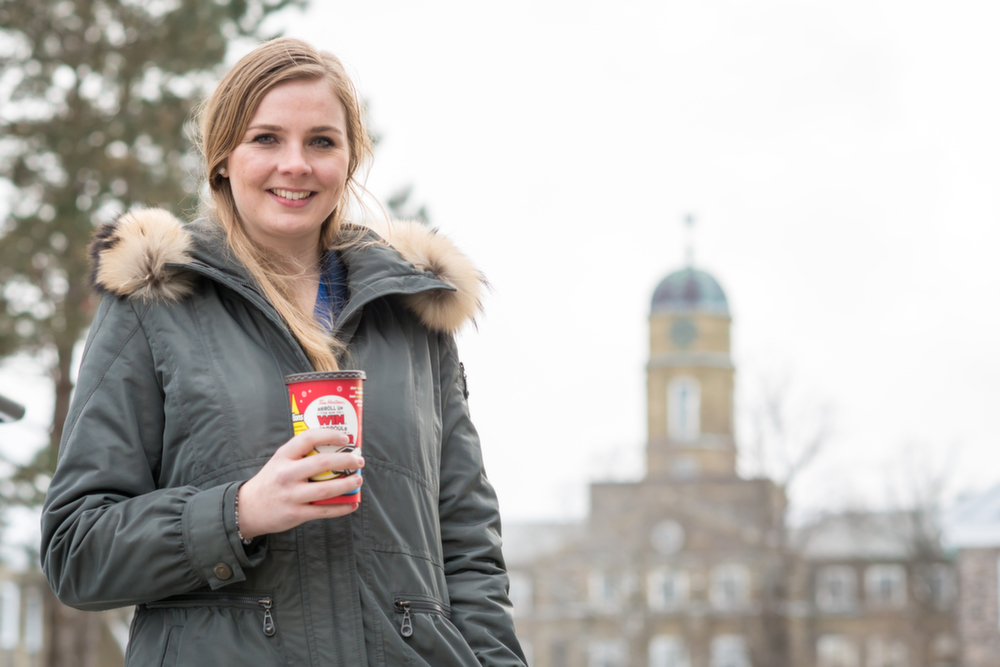 A newcomer to Canada, Desirée Nouwen is eager to embrace local culture—beginning with her choice of beverage. (Photo by Chris Parent)