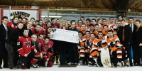 Last year's Bighorns (left) and Trojans put aside their differences in support of the IWK. (Photo by Chris Parent)
