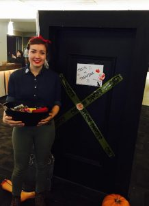 Emmalies Vander-Velde, with the DSU, hands out candy to trick-or-treaters.