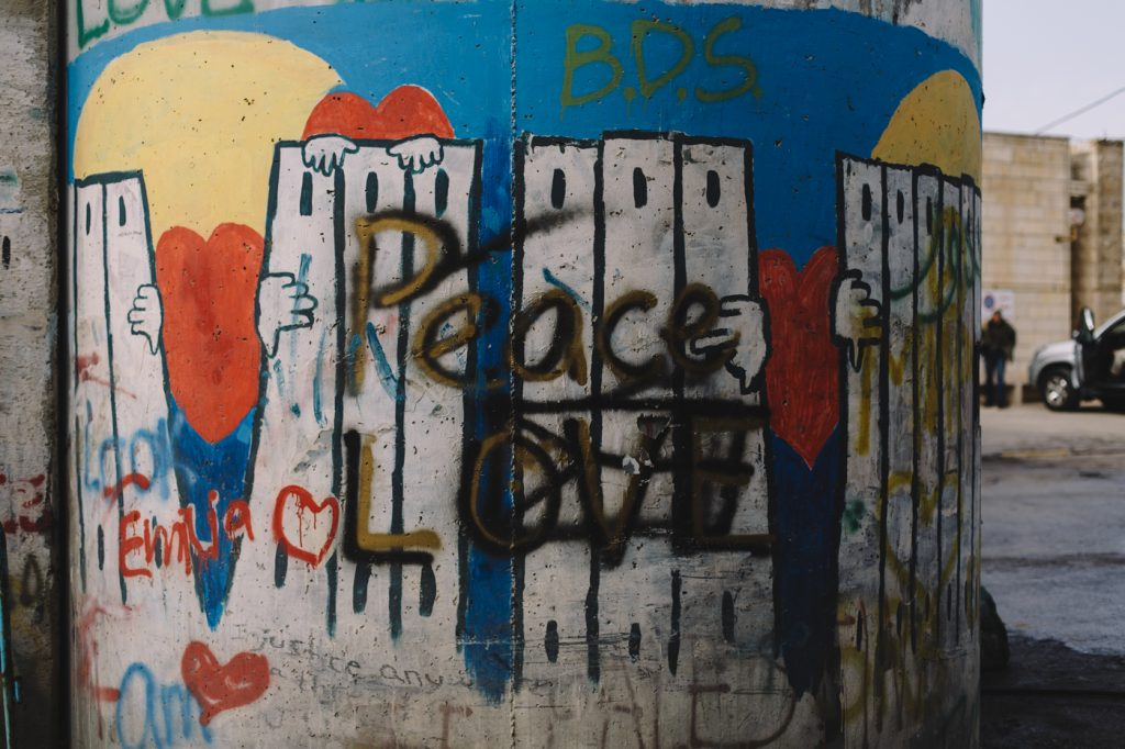 Peace, love, and BDS. Graffiti painted on a pillar of the Separation Barrier. Bethlehem, Palestine.