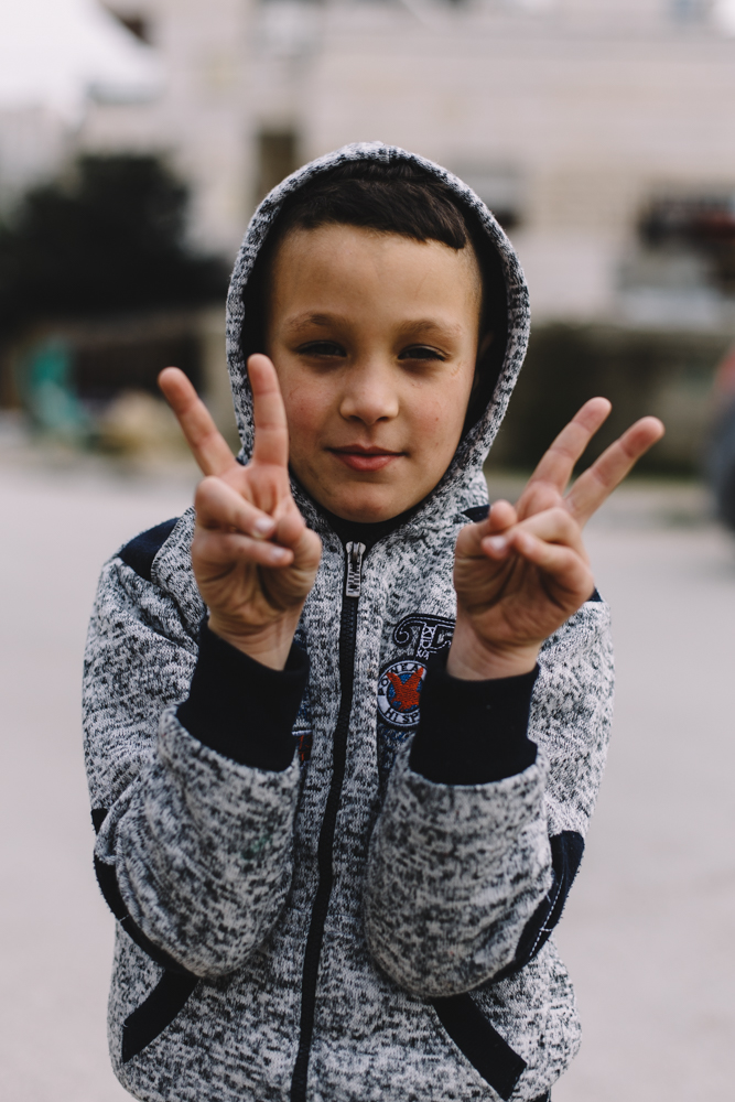 A Palestinian child in Aida refugee camp. Shortly before this photo was taken, another group of children was scared off by the explosion of a smoke or stun grenade set off during an incursion into the camp by Israeli security forces; Bethlehem, Palestine.
