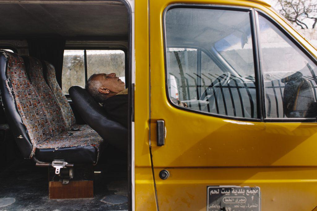 Palestinian man resting in his van; Bethlehem, Palestine.