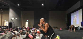 Shaun T helps people physically and emotionally at workout event