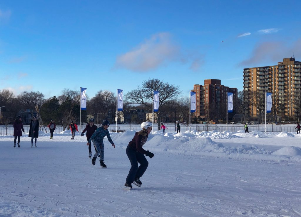 In this image: skaters on the Emera Oval.