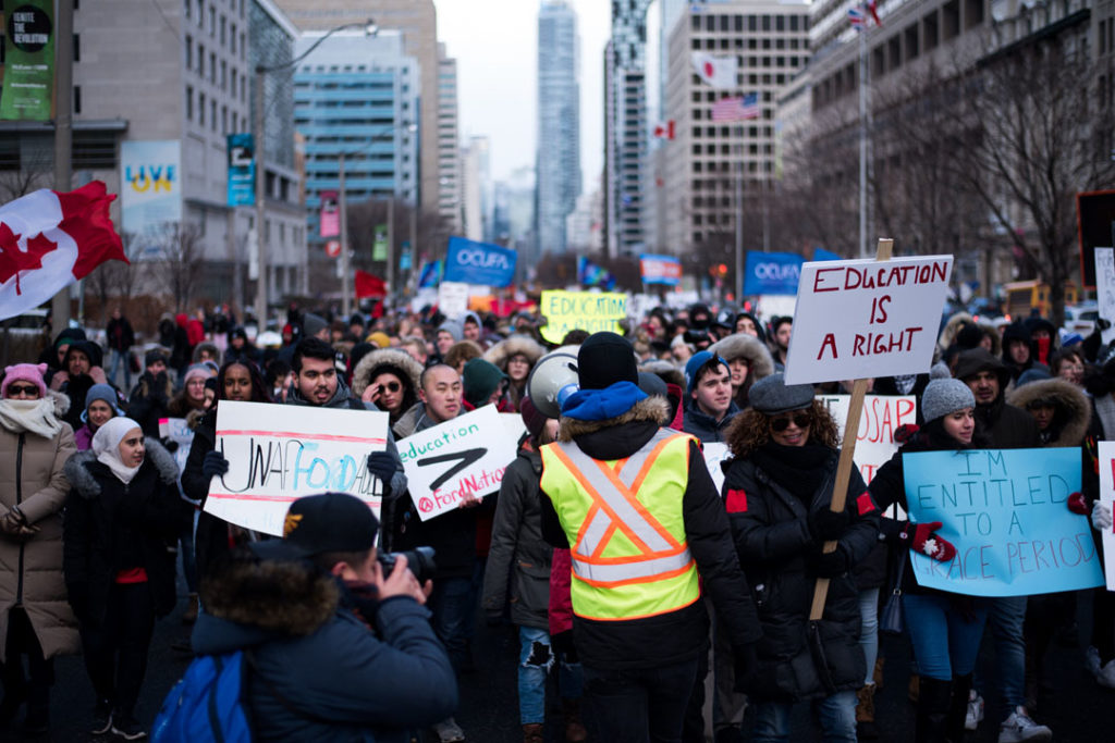In this image: a protest against the Ford Government in Ontario.