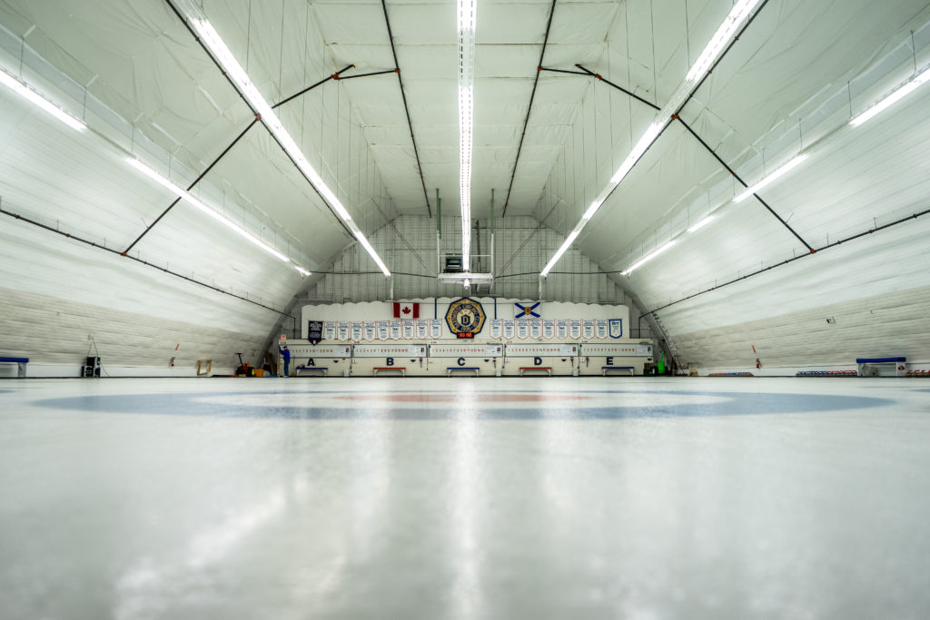 In this image: an ice rink for curling.
