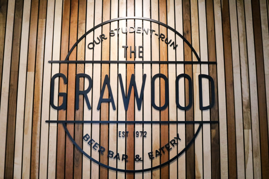 In this image: The Grawood's sign.