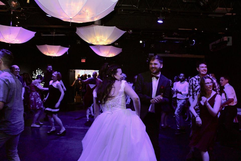In this image: people dancing at a wedding reception.