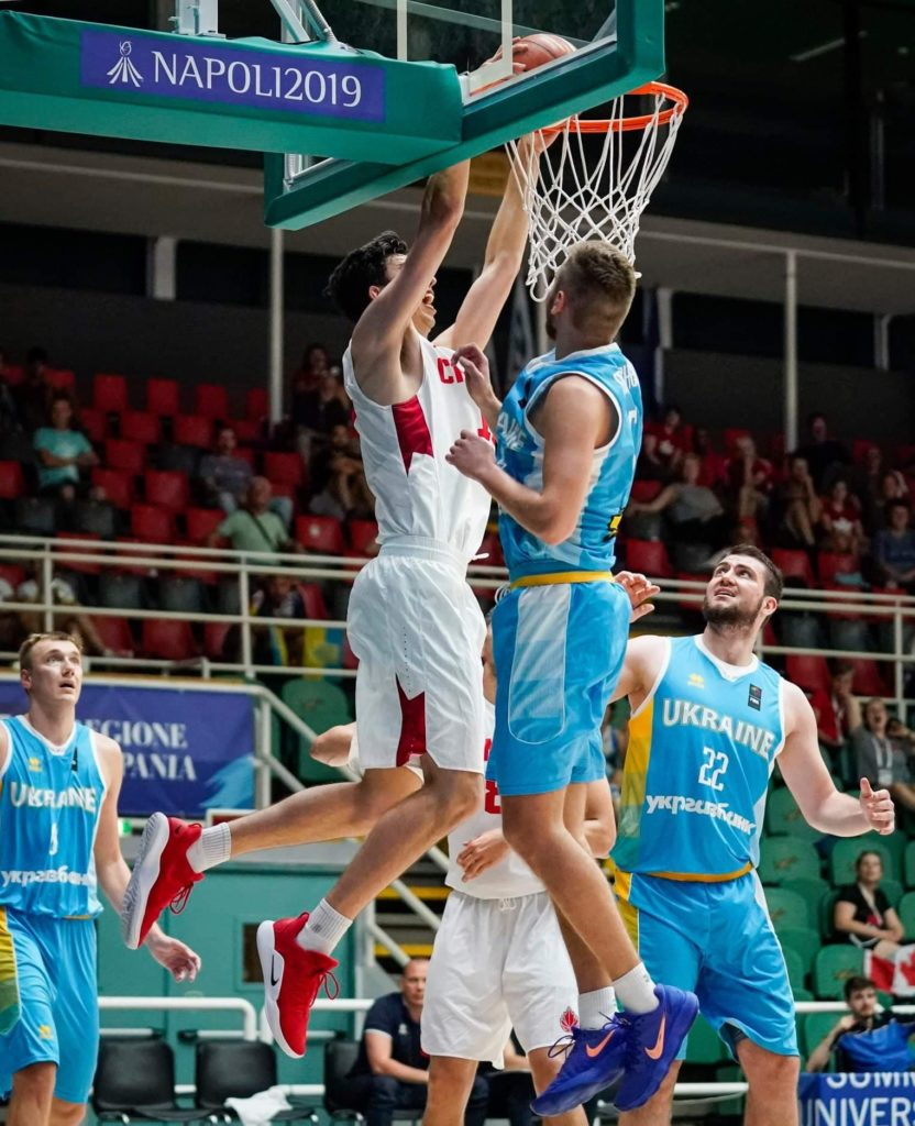 In this image: Sascha Kappos goes to dunk the basketball.