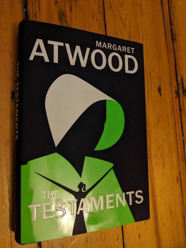 In this image: Book cover of The Testaments.