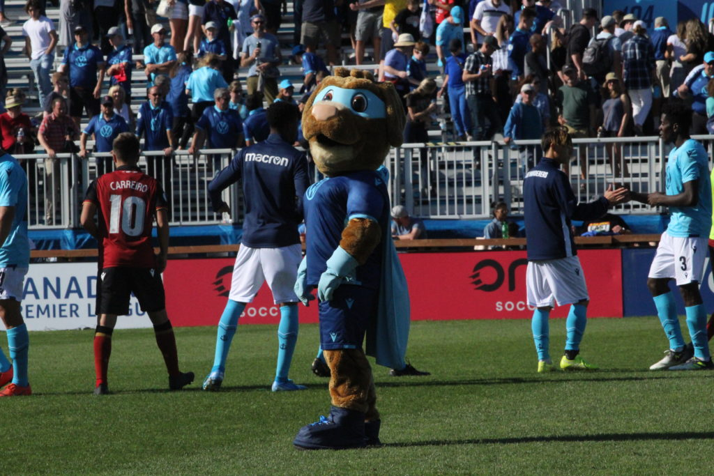In this image: A Halifax Wanderer's mascot on the field.