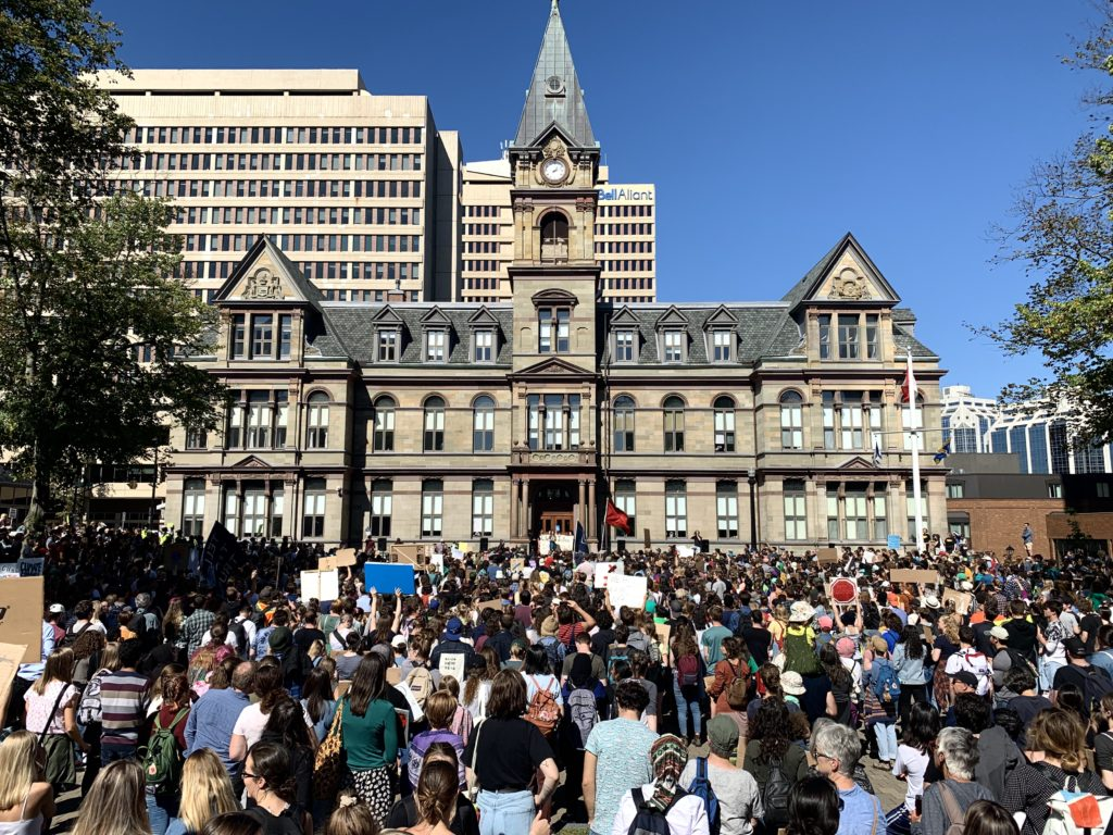 In this image: Protestors during the climate strike fill up Grand Parade in Halifax.