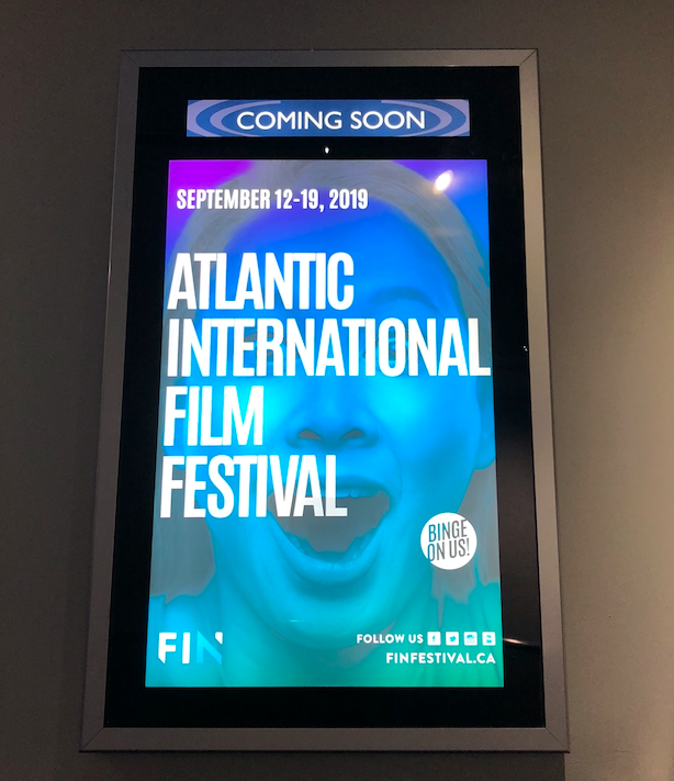 In this image: Atlantic Internationa Film Festival poster.