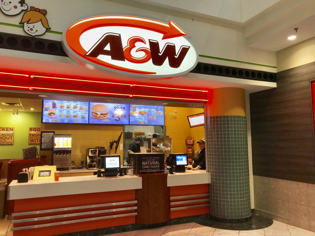 In this image: The front of an A&W location.