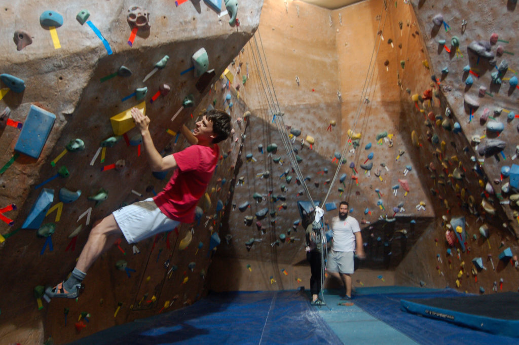 In this image: James Wise climbs a bouldering wall at the Dalplex.