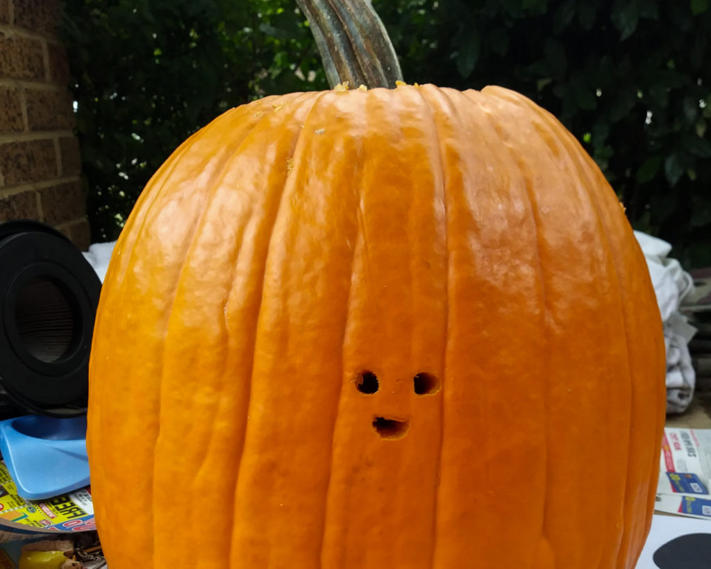In this image: A carved pumpkin.