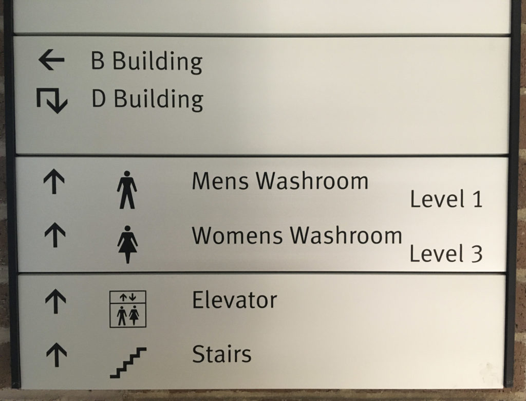 In this image: A directory in the B-Building showing the men's washroom on level 1 and the women's washroom on level 3.