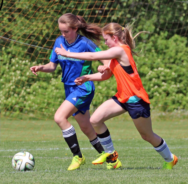 In this image: Alexi Armstrong playing a game with her high school soccer team.