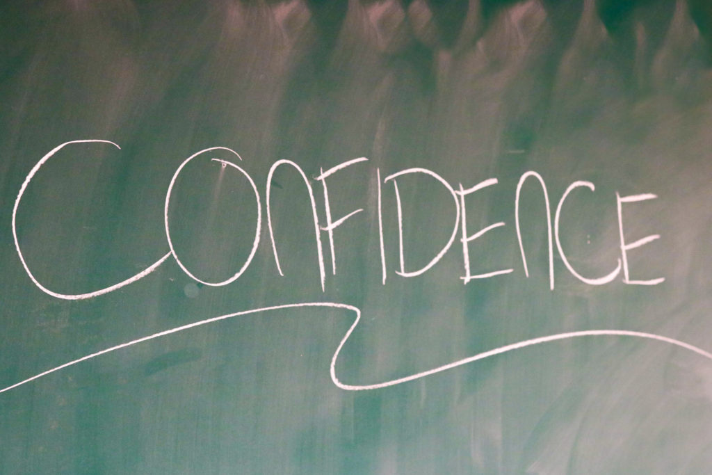 "In this image: ""Confidence"" written on a chalkboard."