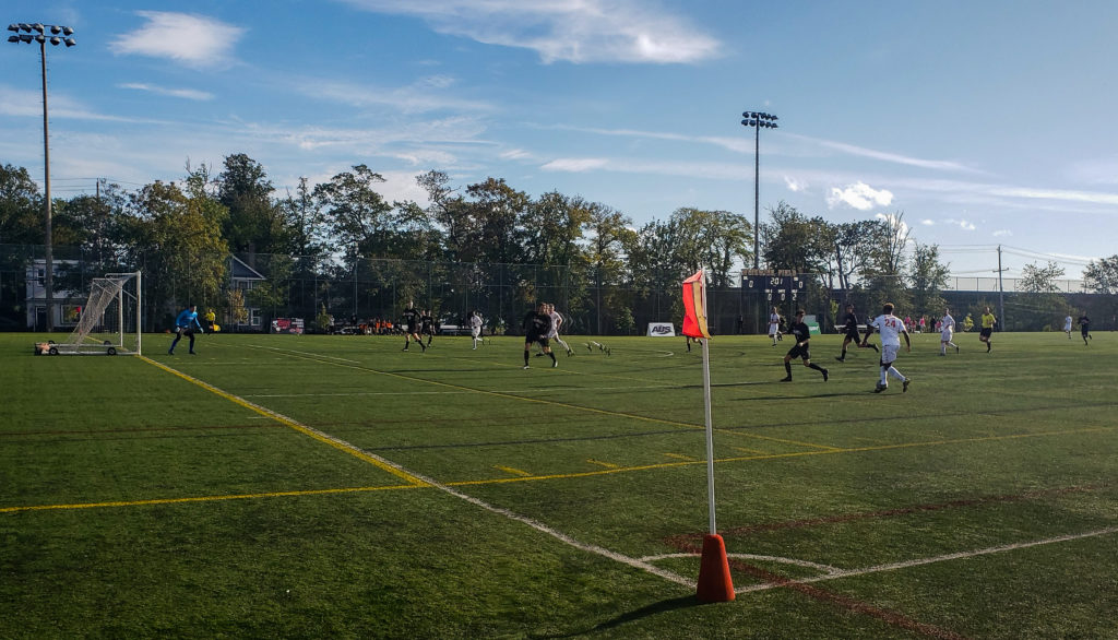 In this image: A game between Dalhousie University's men's soccer team and the Cape Breton Capers during the 2019-2020 season.