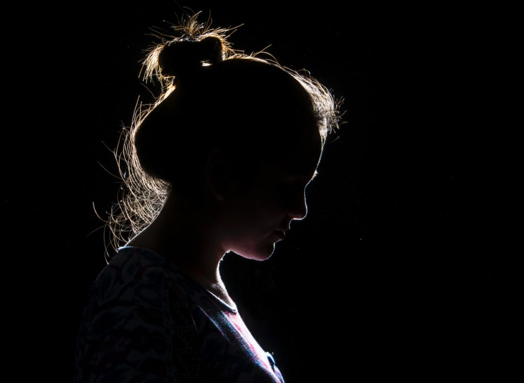 In this image: A silhouette of a woman.