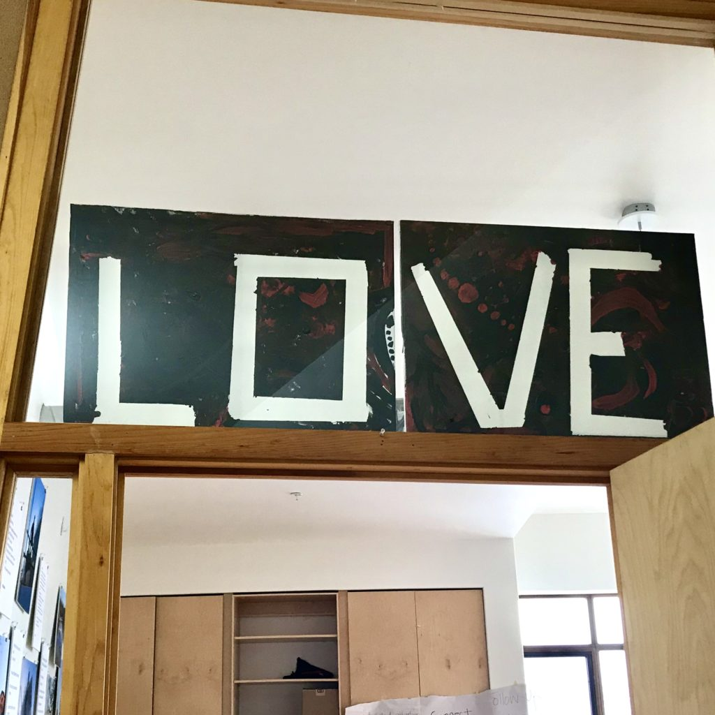 """In this image: A sign saying """"LOVE."""""""