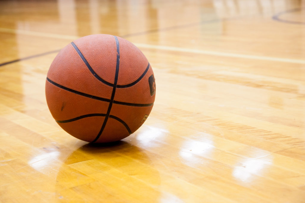 In this image: A basketball in gymnasium.