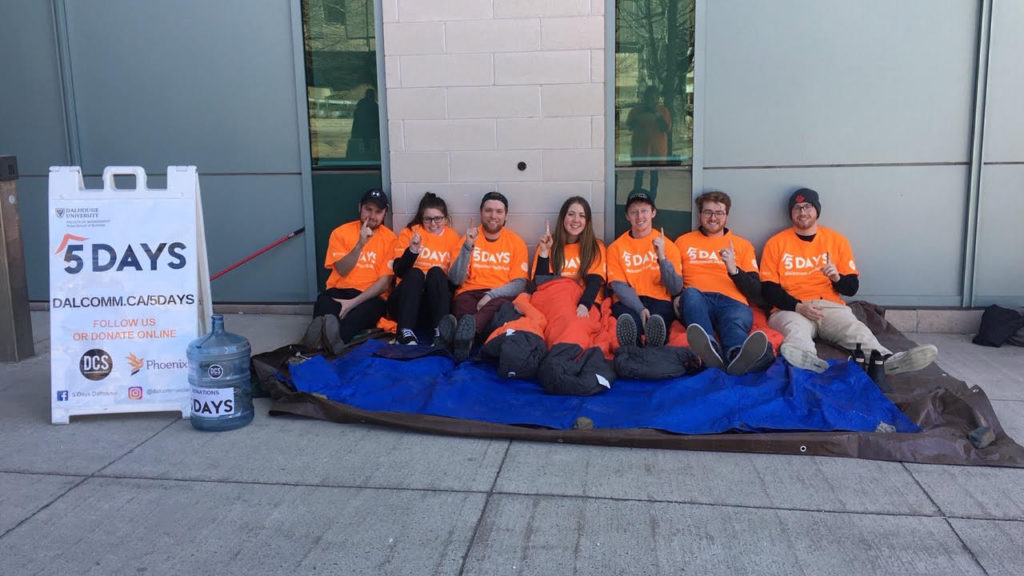 In this image: Dalhousie Commerce Society members sitting outside for 5 Days.